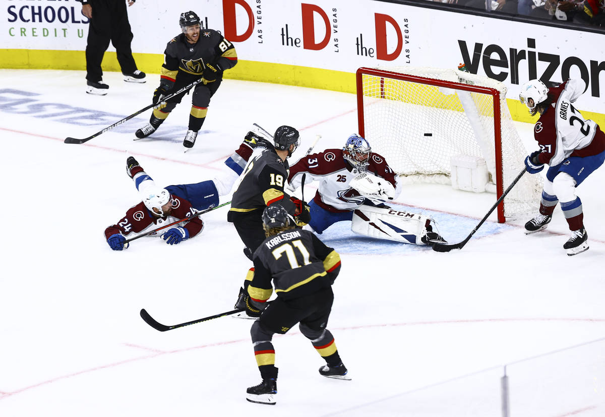 Golden Knights' Jonathan Marchessault (81) watches his shot go in against Colorado Avalanche go ...