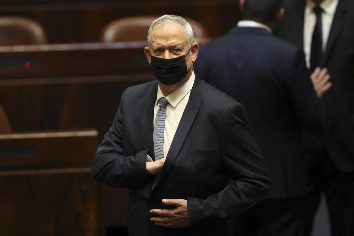 Israeli politician Benny Gantz stands during a Knesset session in Jerusalem Sunday, June 13, 20 ...
