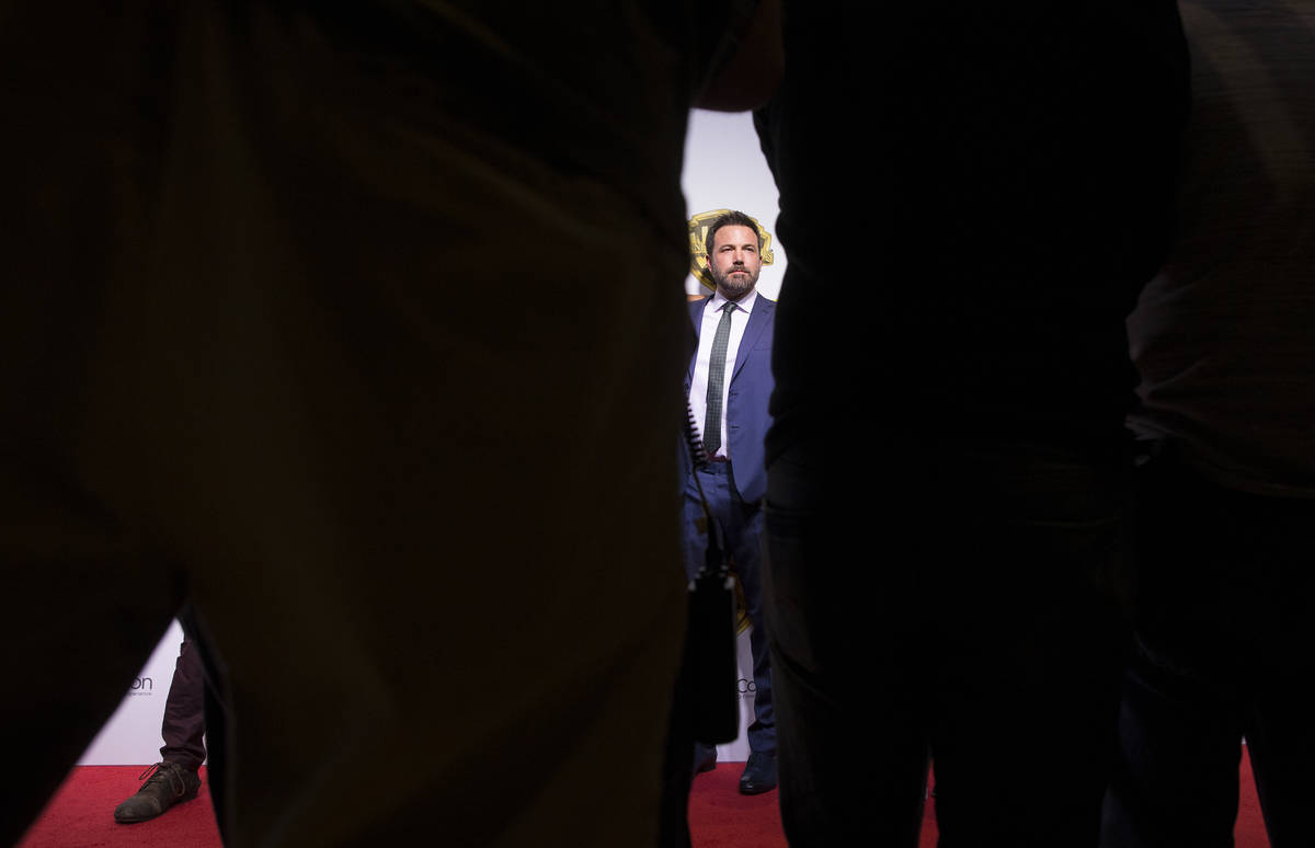 Actor Ben Affleck poses for photos during the Warner Bros. red carpet event at CinemaCon on Wed ...