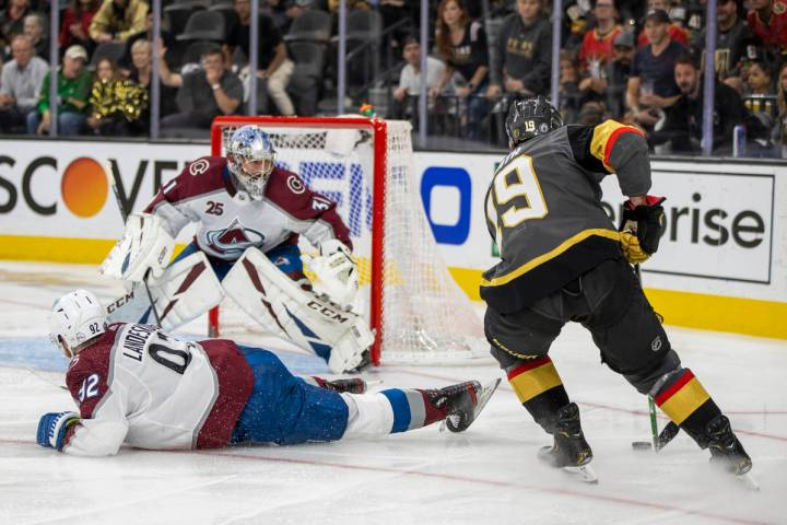 Golden Knights right wing Reilly Smith (19) looks to shoot past Colorado Avalanche left wing Ga ...