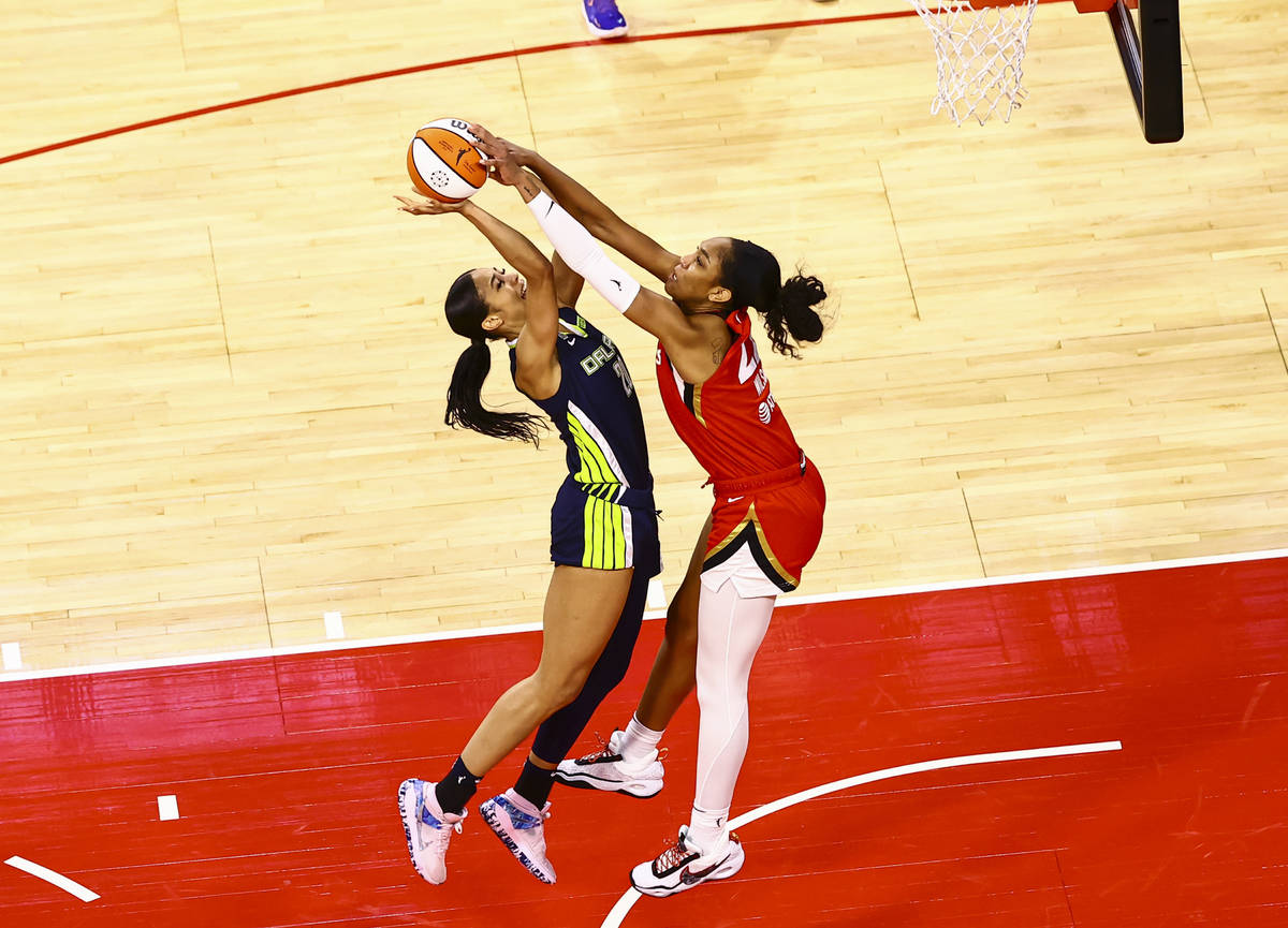 Las Vegas Aces' A'ja Wilson, right, blocks a shot from Dallas Wings' Isabelle Harrison during t ...
