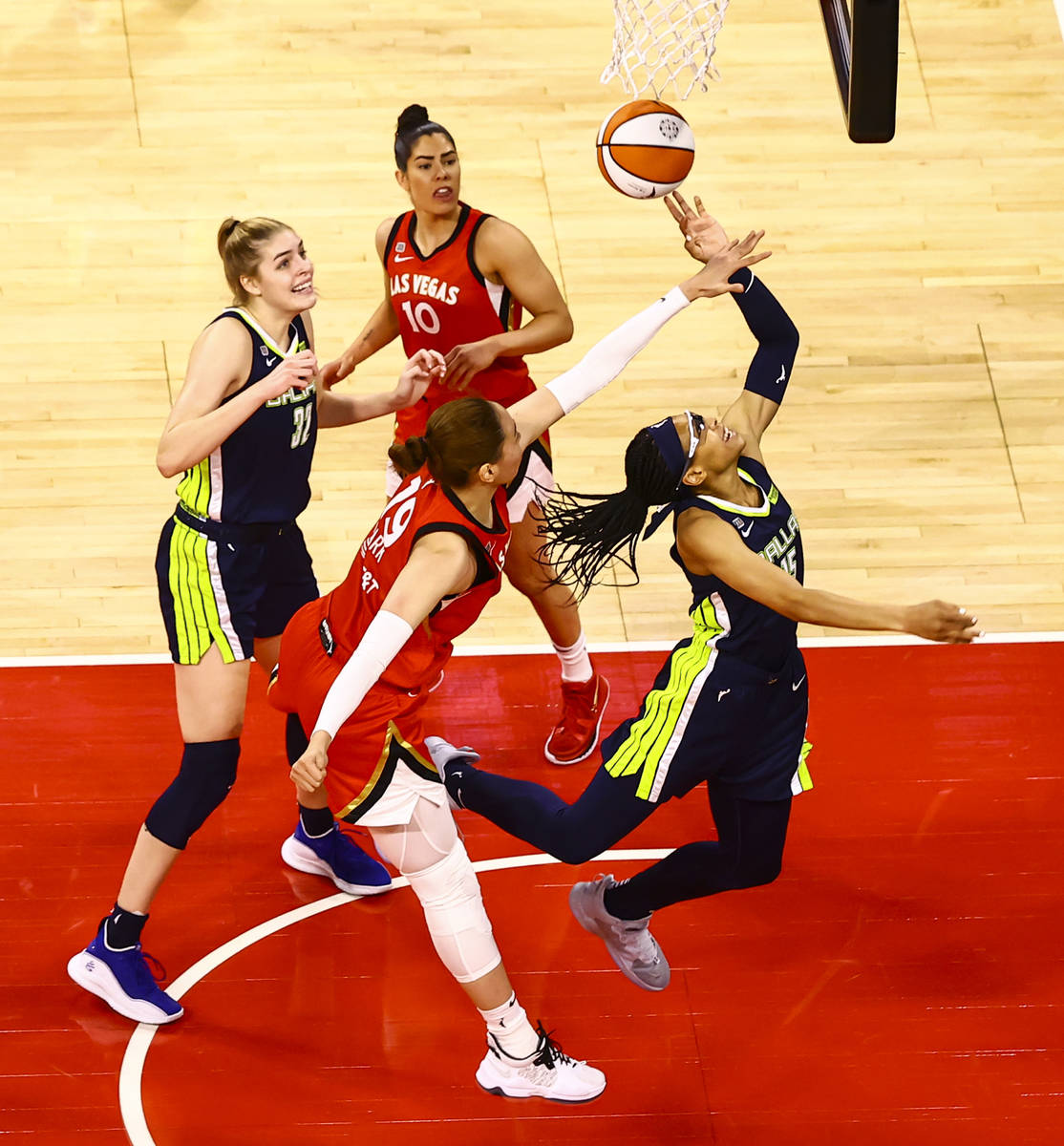 Dallas Wings' Allisha Gray, right, gets fouled by Las Vegas Aces' JiSu Park (19) during ...