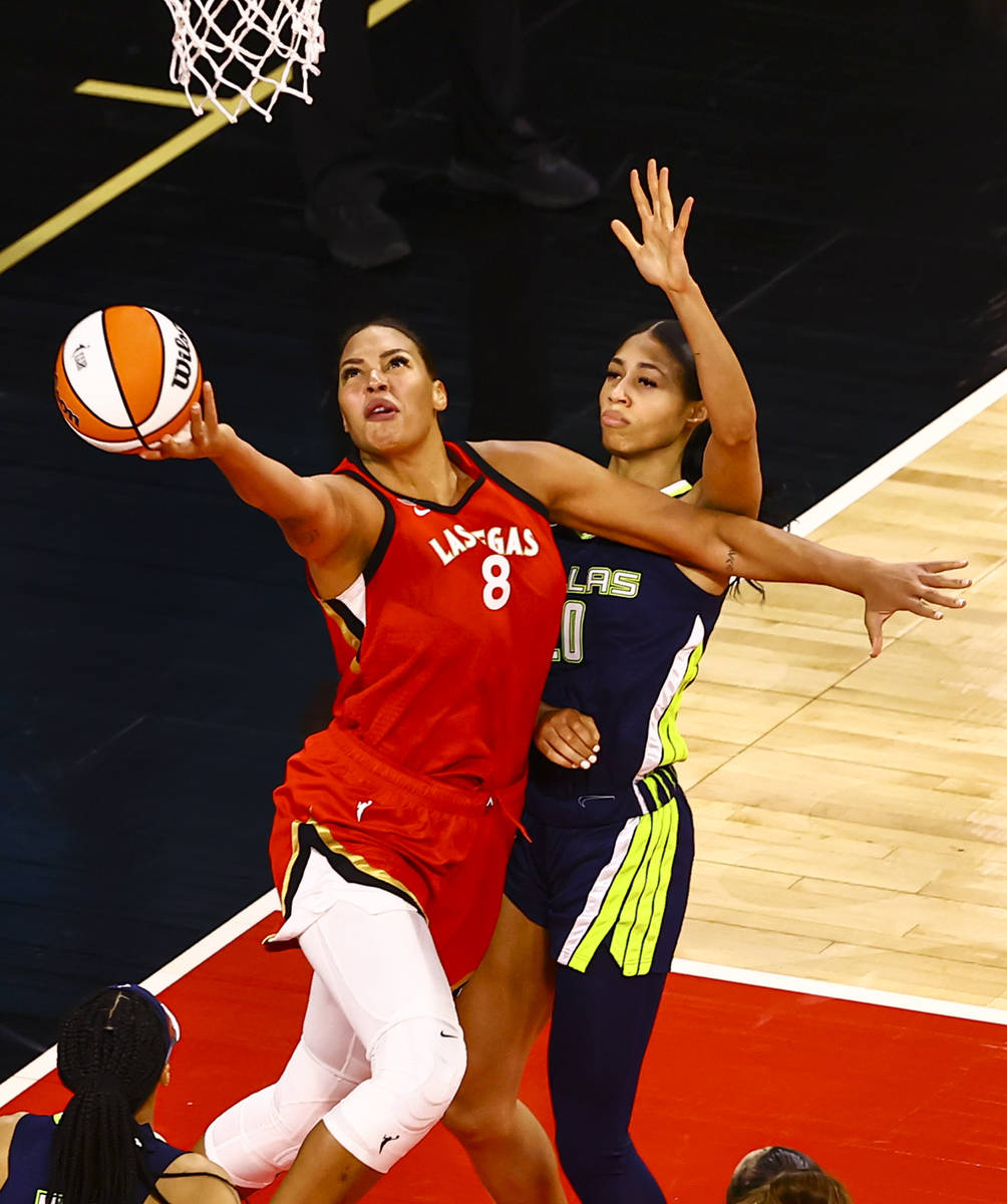 Las Vegas Aces' Liz Cambage (8) shoots in front of Dallas Wings' Isabelle Harrison (20) during ...