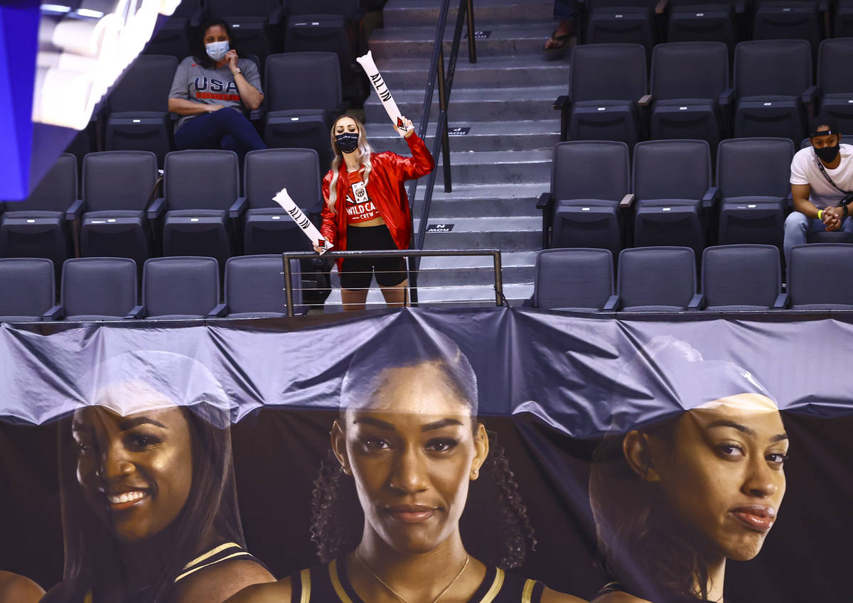 A member of the Las Vegas Aces Wild Card crew cheers during the second quarter of a WNBA basket ...