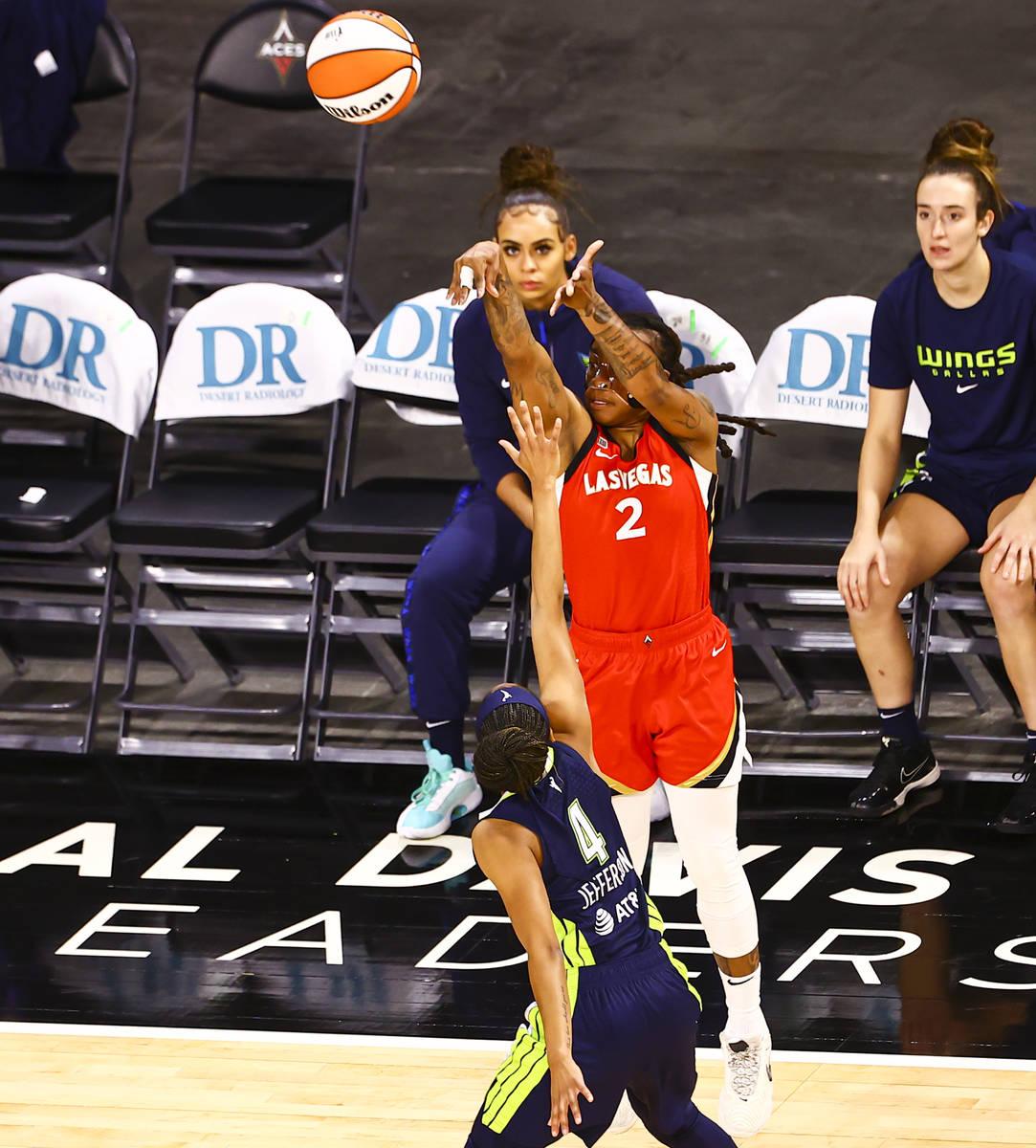 Las Vegas Aces' Riquna Williams (2) shoots over Dallas Wings' Moriah Jefferson (4) during the f ...