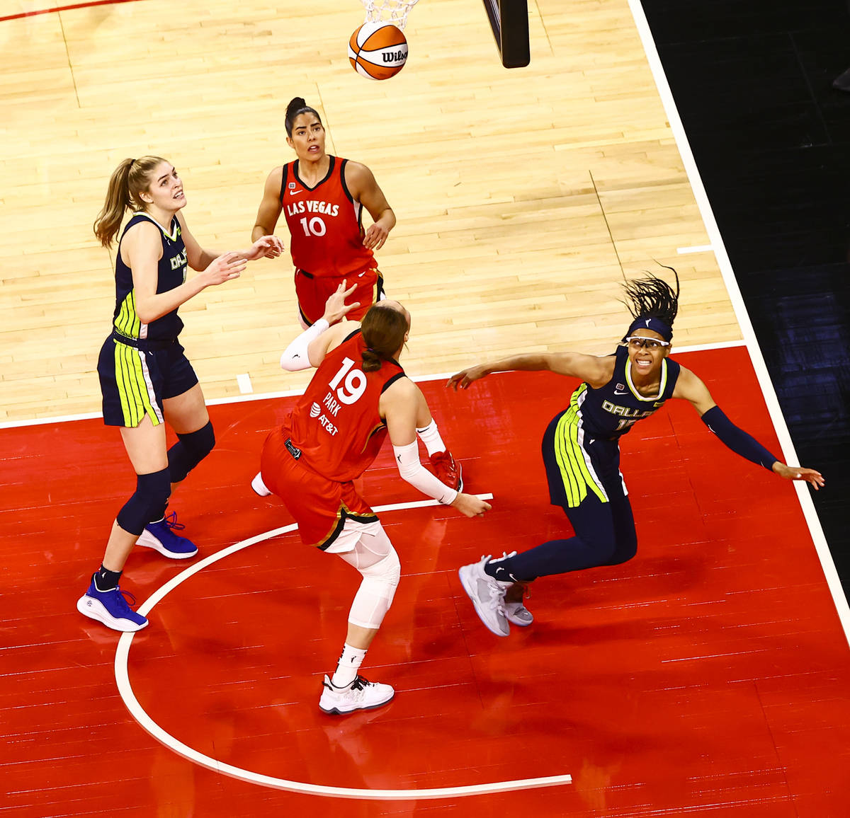 Dallas Wings' Allisha Gray, right, watches her shot after getting fouled by Las Vegas Ac ...