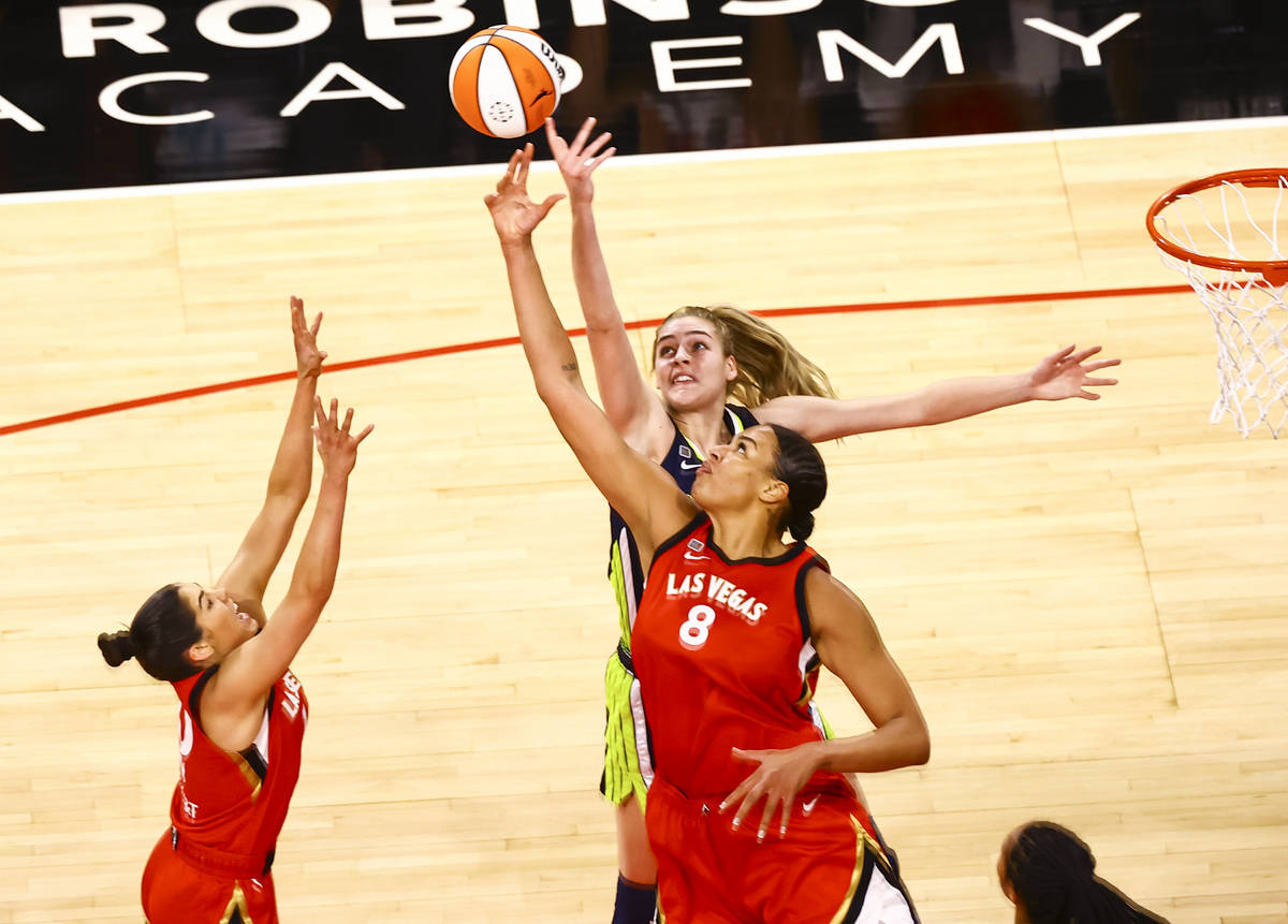 Dallas Wings' Bella Alarie, above, and Las Vegas Aces' Liz Cambage (8) battle for a rebound dur ...