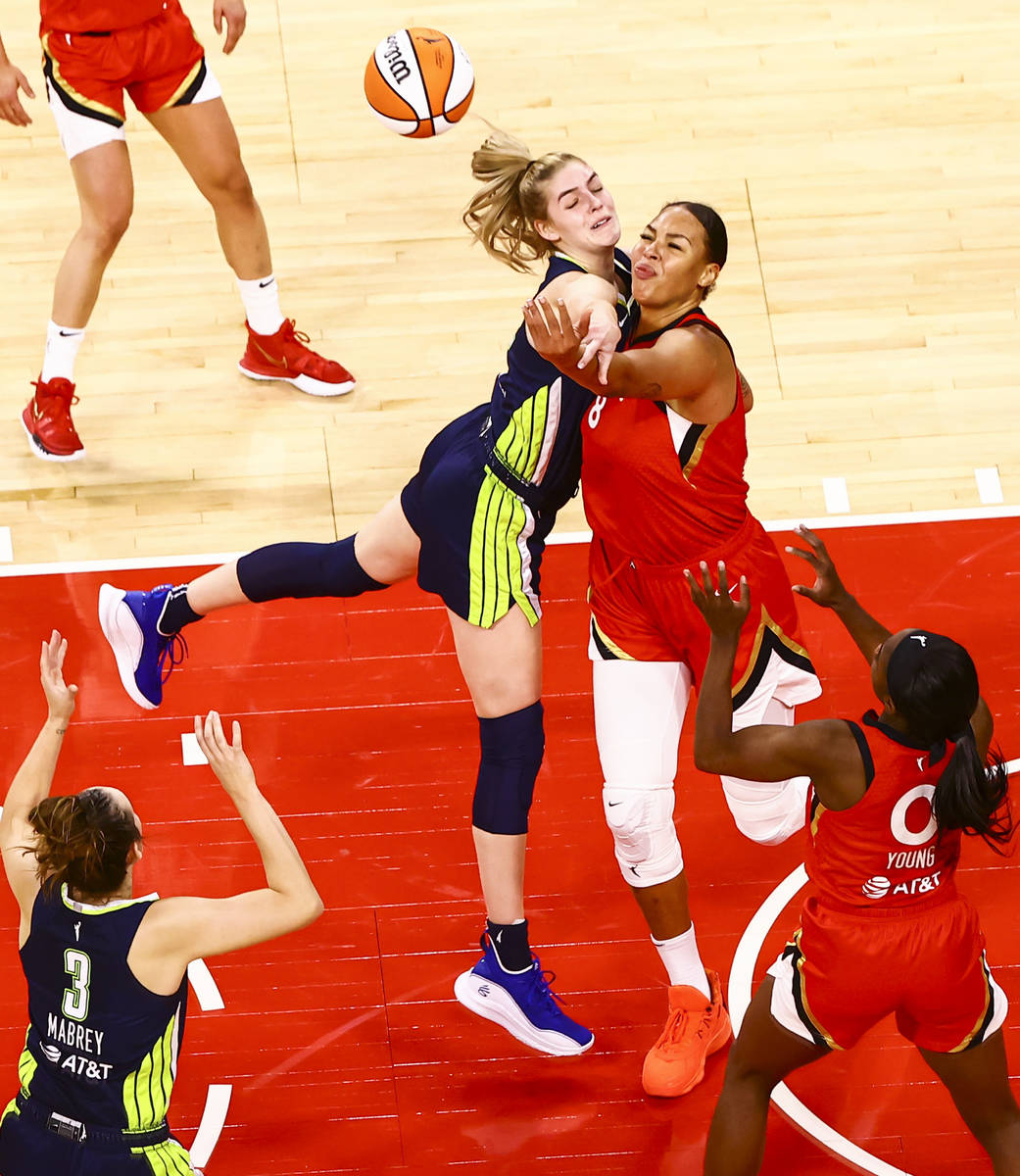 Dallas Wings' Bella Alarie (32) and Las Vegas Aces' Liz Cambage (8) battle for a rebound during ...