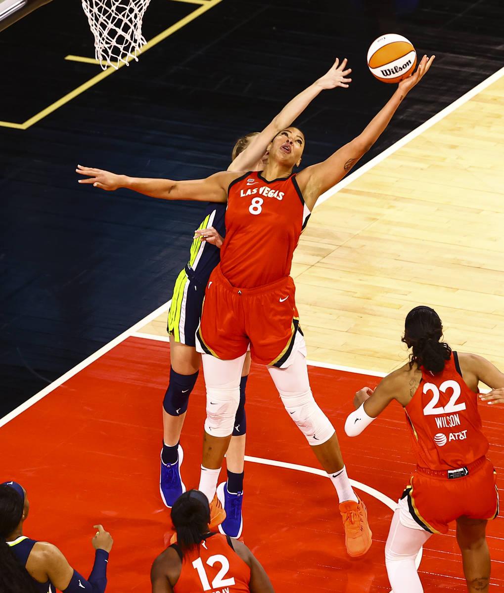Las Vegas Aces' Liz Cambage (8) grabs a rebound against Dallas Wings' Bella Alarie (32) during ...
