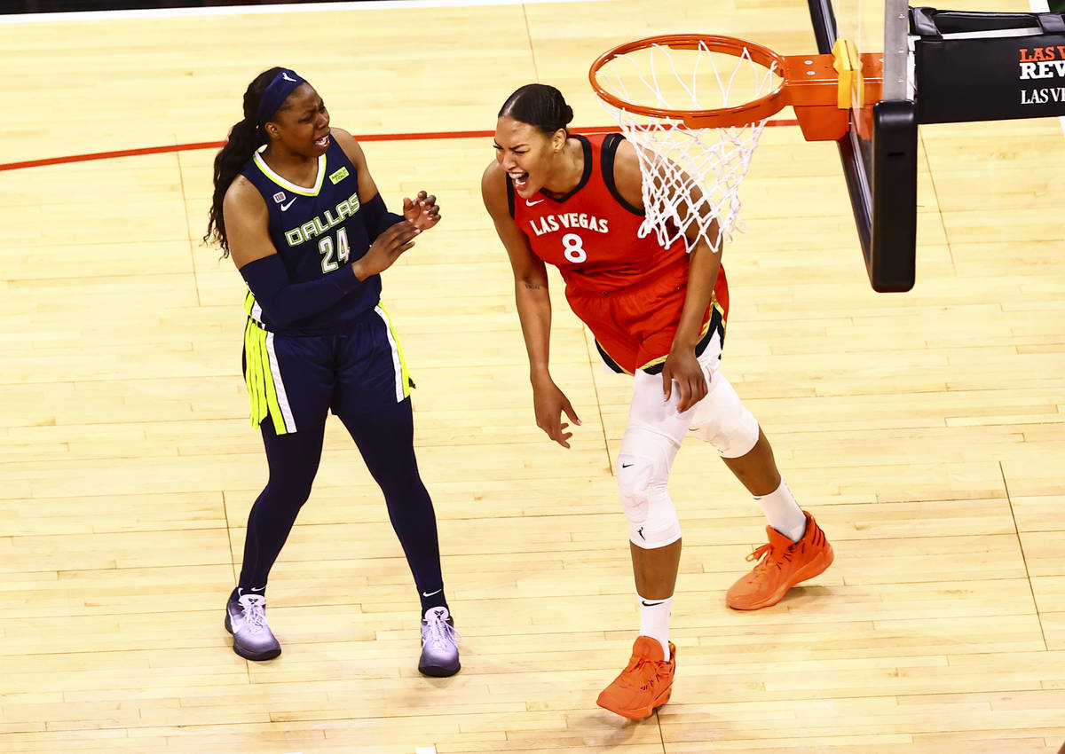 Las Vegas Aces' center Liz Cambage (8) reacts after scoring in front of Dallas Wings' guard Ari ...