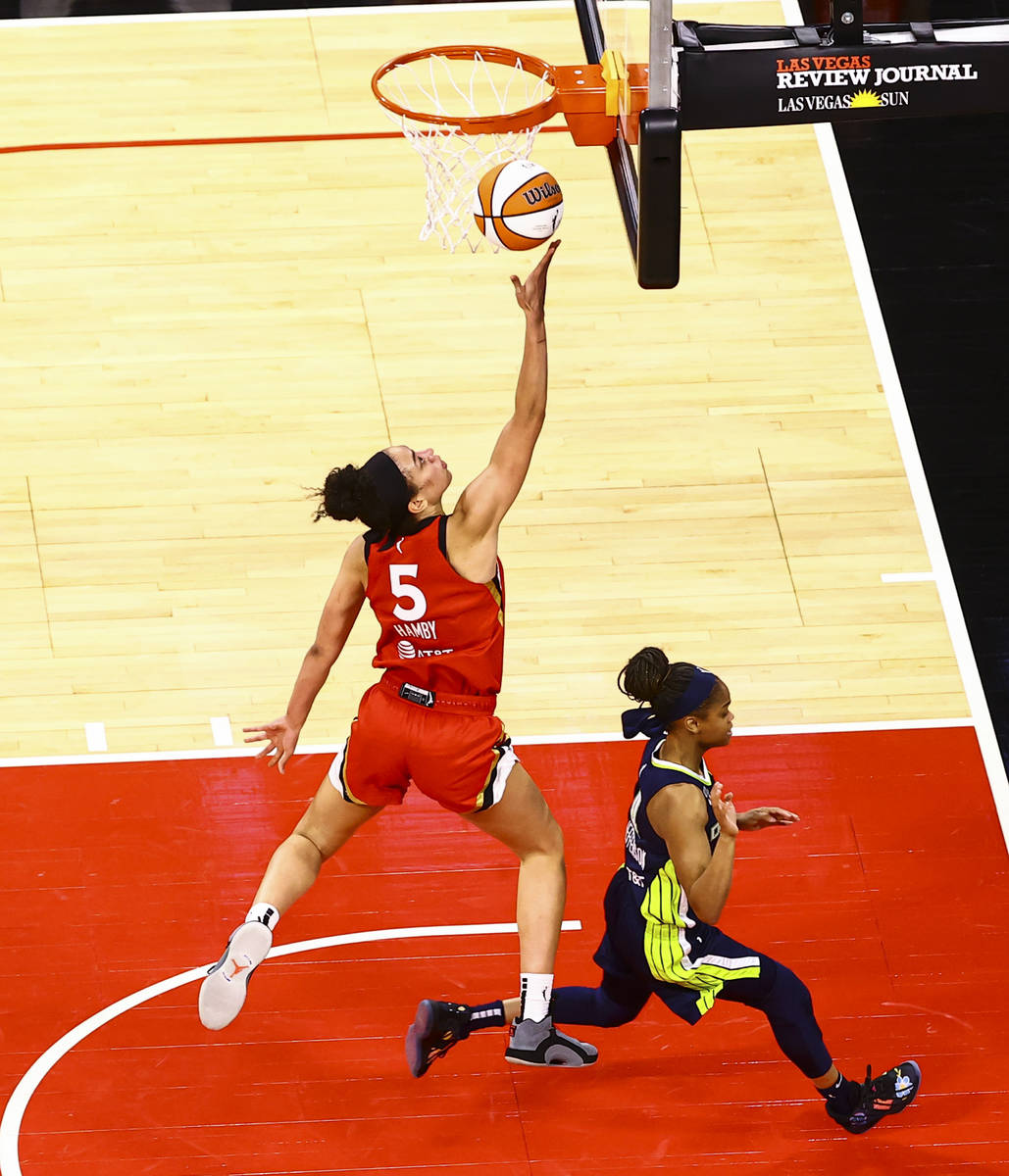 Las Vegas Aces' Dearica Hamby (5) shoots against Dallas Wings' Moriah Jefferson during the four ...