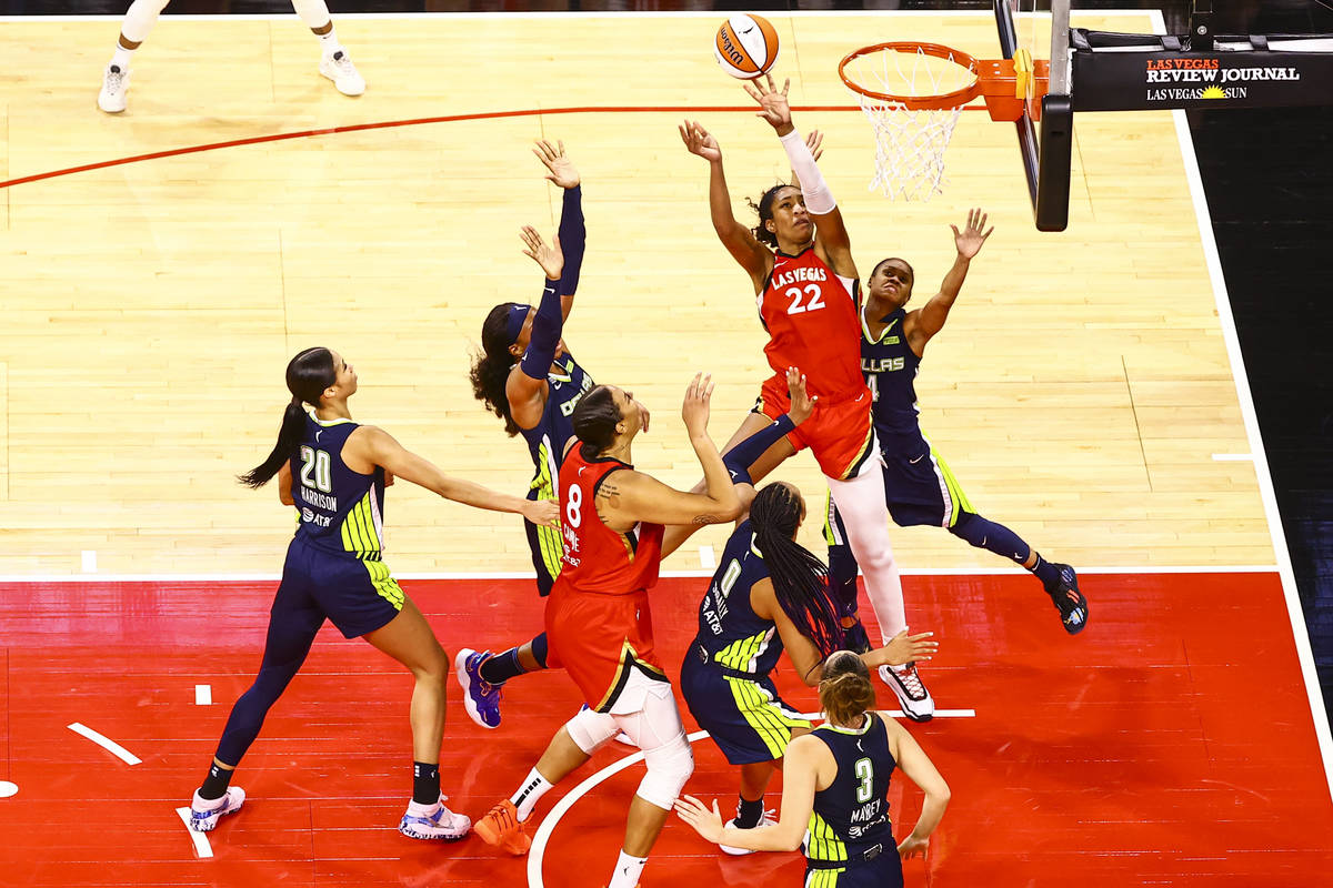 Las Vegas Aces' A'ja Wilson (22) shoots in front of Dallas Wings' Moriah Jefferson (4) during t ...