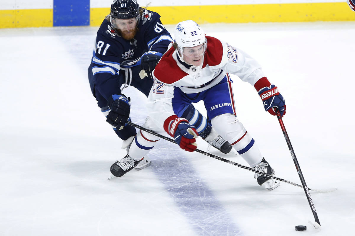 Winnipeg Jets' Kyle Connor (81) chases Montreal Canadiens' Cole Caufield (22) during the second ...