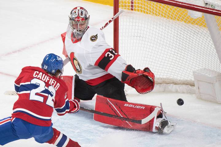 In this May 1, 2021, file photo, Montreal Canadiens' Cole Caufield scores against Ottawa Senato ...