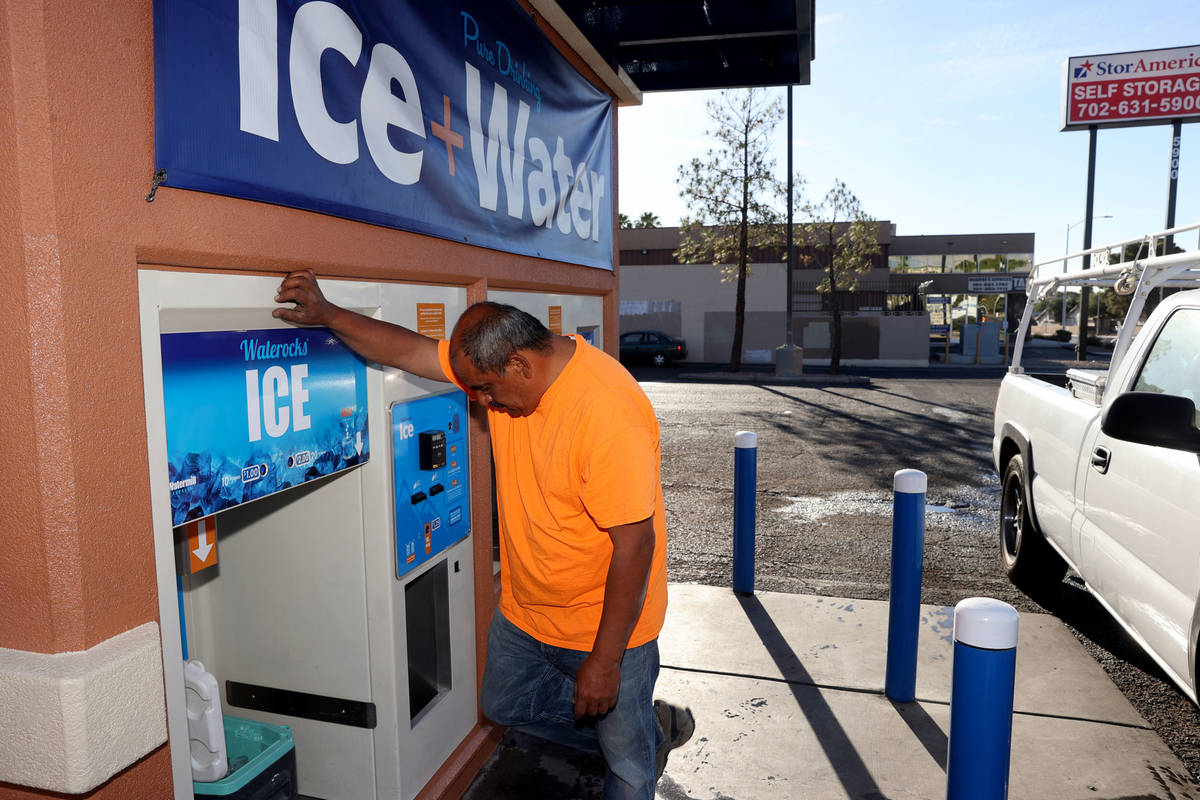 Ramiro Torres gets ice for his work day at a kiosk on the corner of Smoke Ranch Road and Jones ...