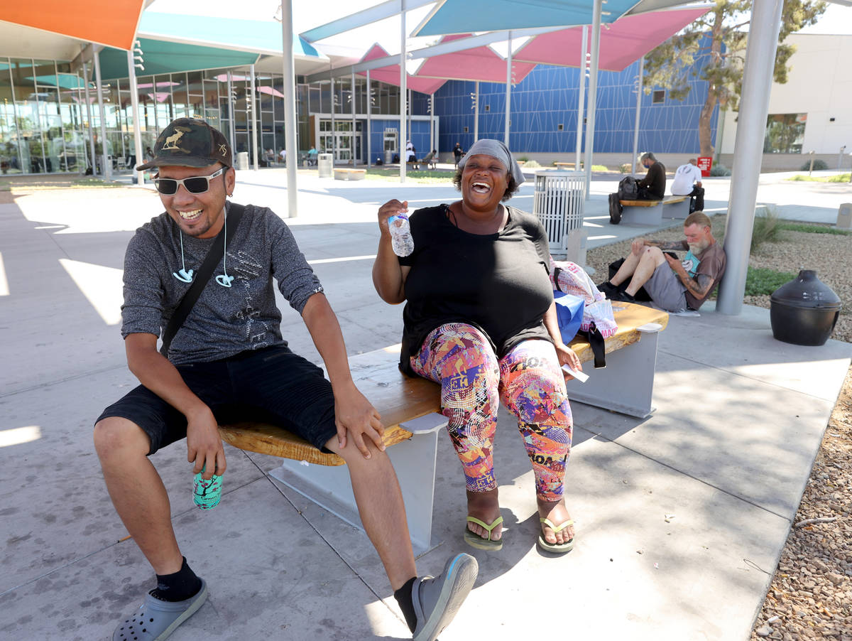 Ket Then, left, and Vaniqueka Dixon hydrate in the shade while waiting for the East Las Vegas L ...