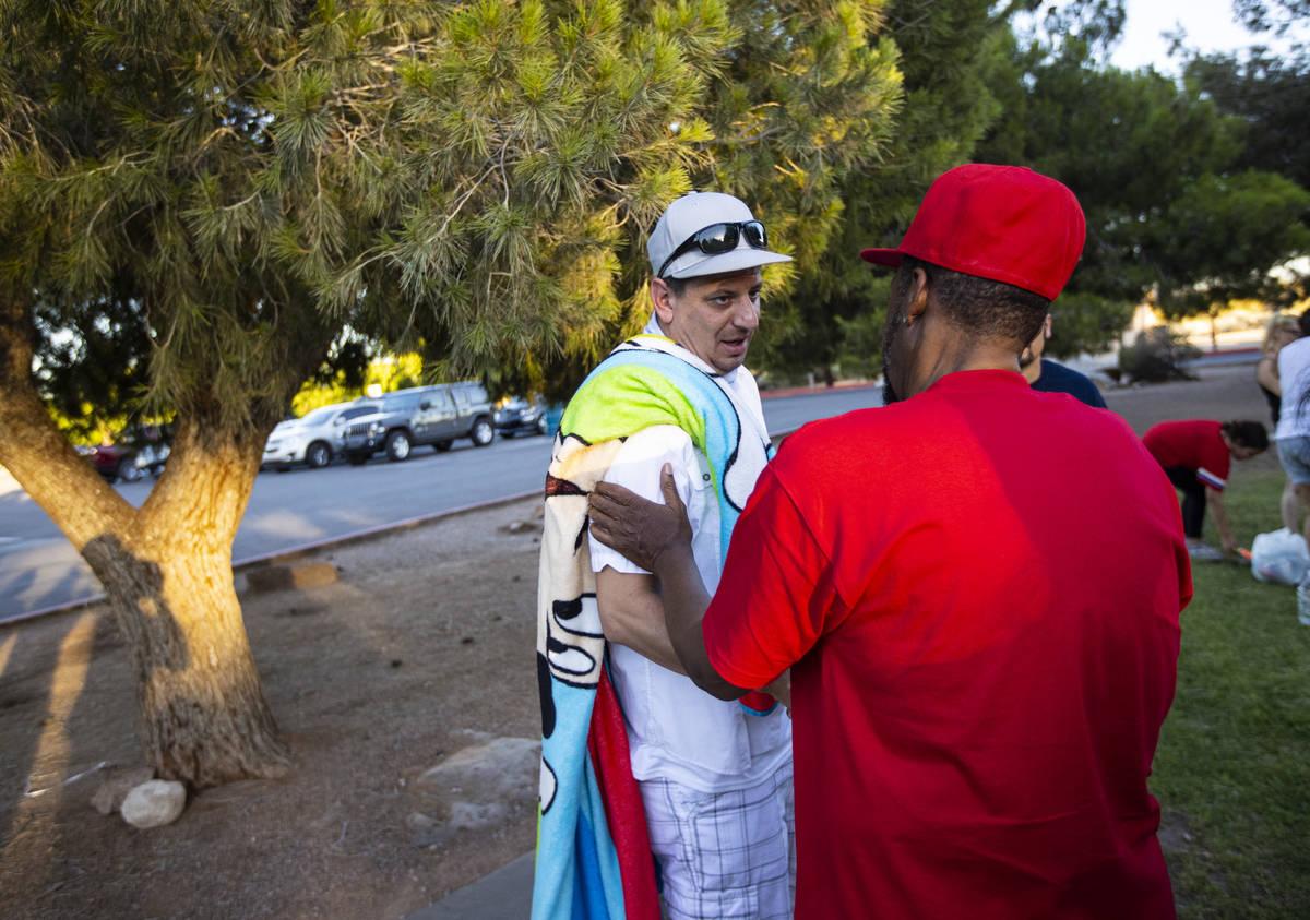 Andre Crockett, of North Las Vegas, right, greets Nicholas Husted, of San Jose, whose son, Liam ...