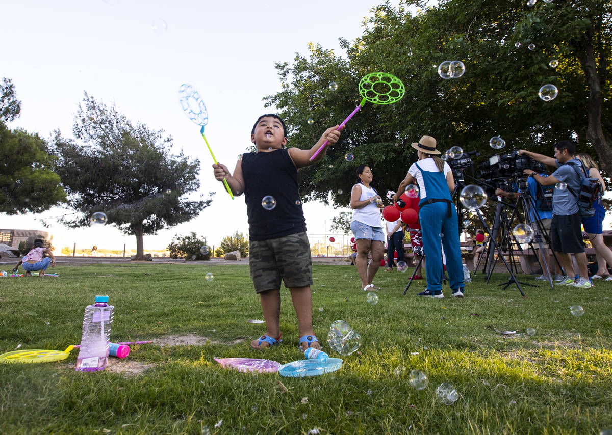 Aiden Trujillo-Maldonado, 3, of Las Vegas, plays with bubbles during a vigil in memory of Liam ...