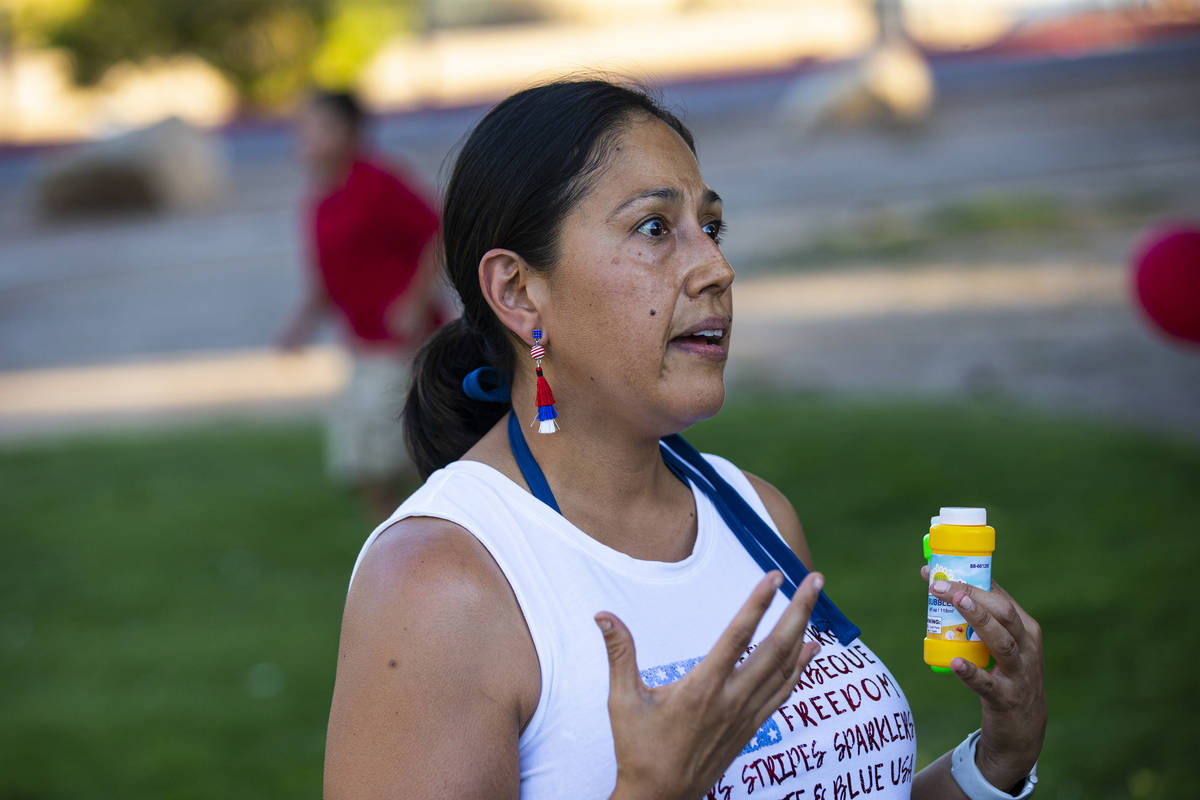 Dina Lynn, of Las Vegas, speaks during a vigil in memory of Liam Husted, who was found slain ne ...