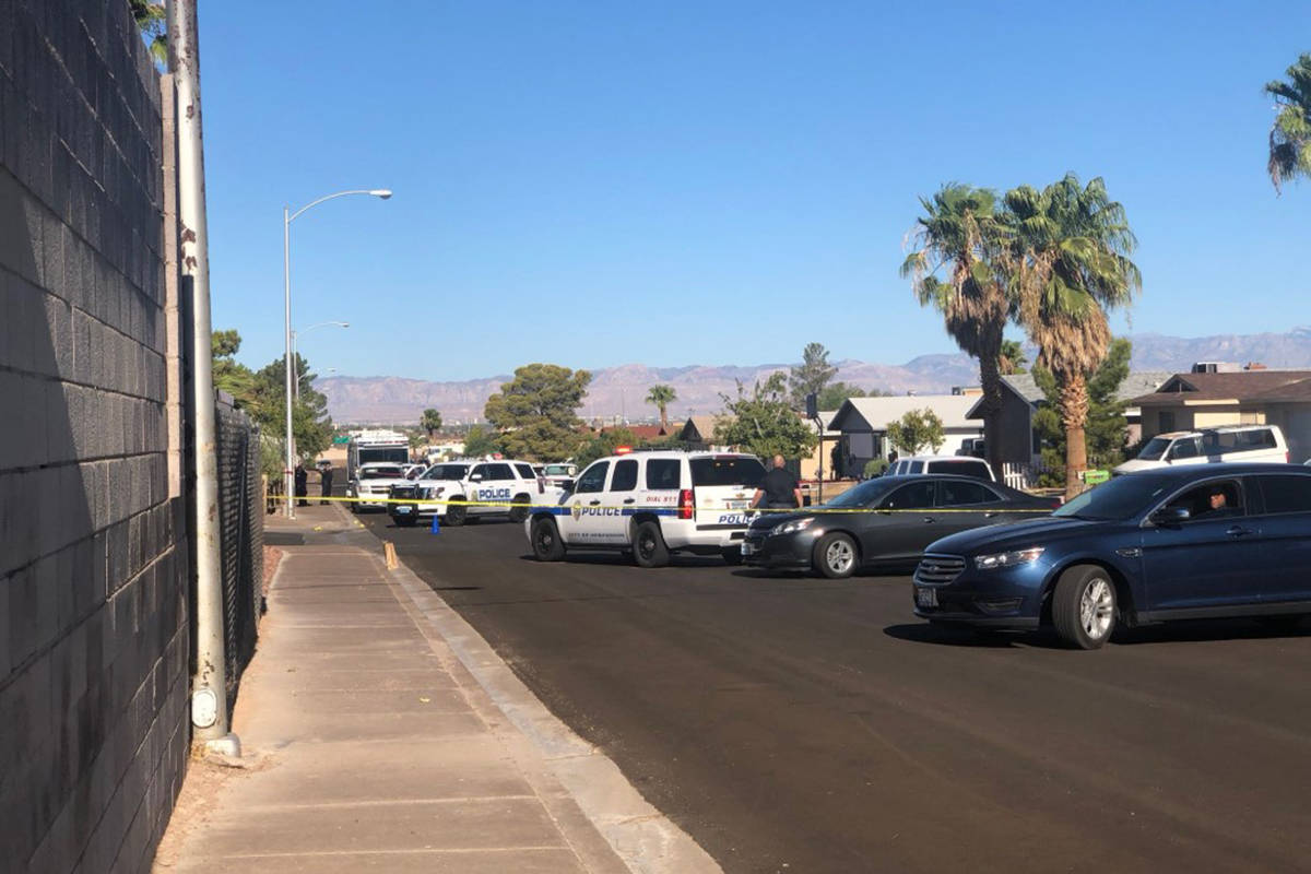 Police are on the scene of an officer-involved shooting Saturday, Aug. 1, 2020, in a residentia ...