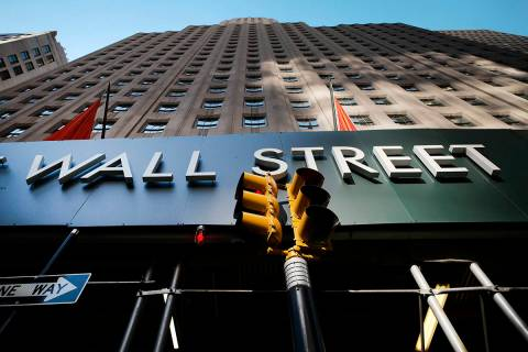 In this May 19, 2021 file photo, a sign for a Wall Street building is shown, Wednesday, May 19, ...