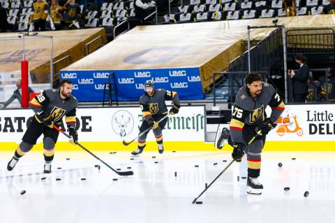 Golden Knights' Ryan Reaves (75) skates onto the ice with teammates to warm up before taking on ...
