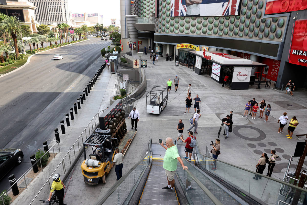 """Workers move the """"Crazy Girls"""" bronze statue from Planet Hollywood Resort Tuesday, Ju ..."""