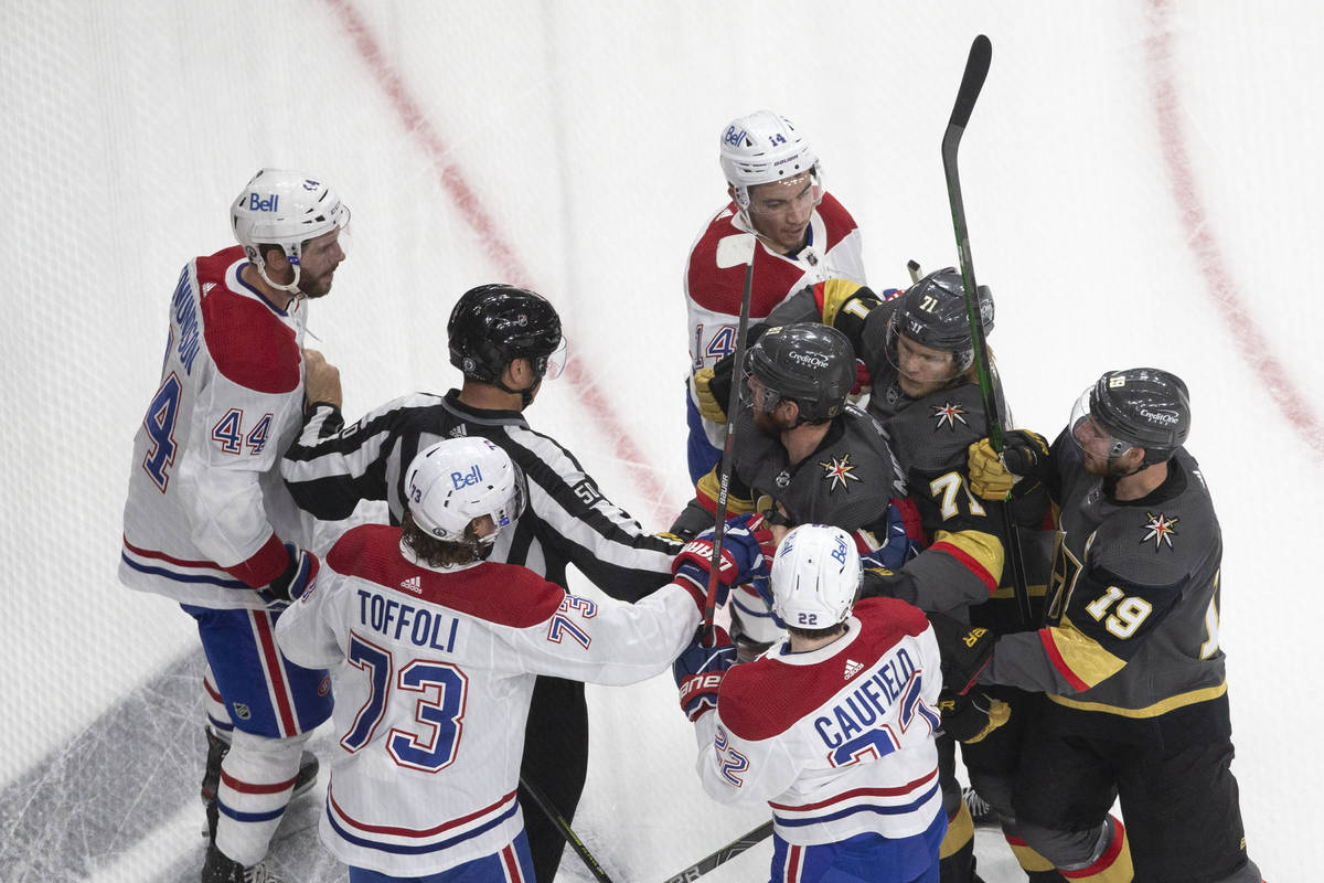Players get into a scuffle, including Golden Knights defenseman Alex Pietrangelo (7) and Canadi ...