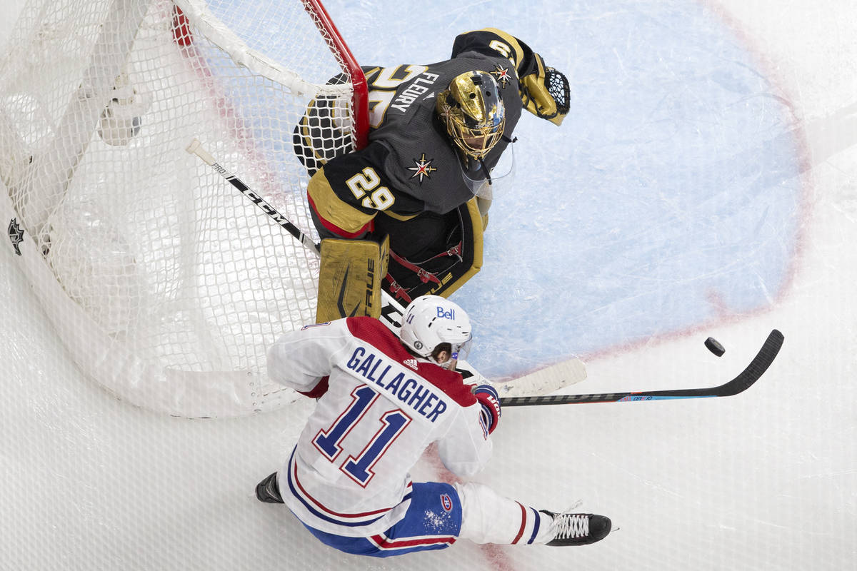 Canadiens right wing Brendan Gallagher (11) unsuccessfully attempts a shot on Golden Knights go ...
