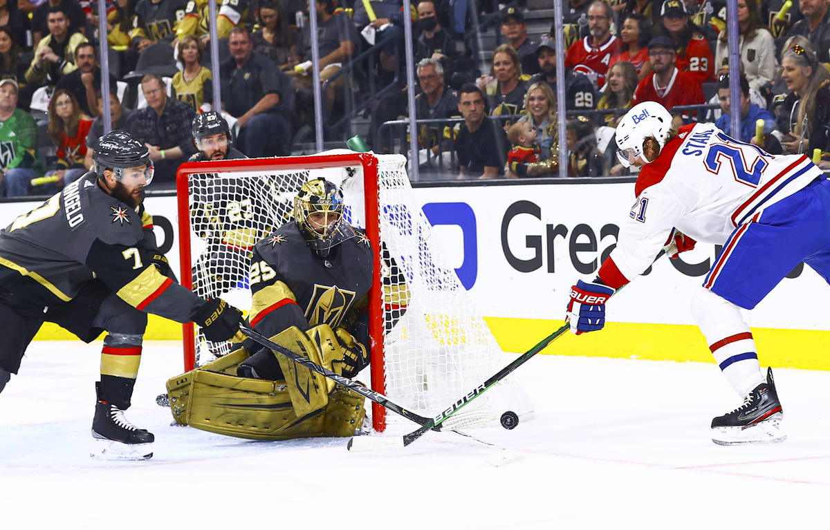 A scoring attempt by Montreal Canadiens' Eric Staal (21) gets stopped by Golden Knights' Alex P ...