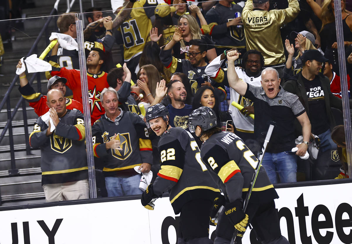 Golden Knights fans celebrate after a goal by Mattias Janmark, not pictured, during the second ...