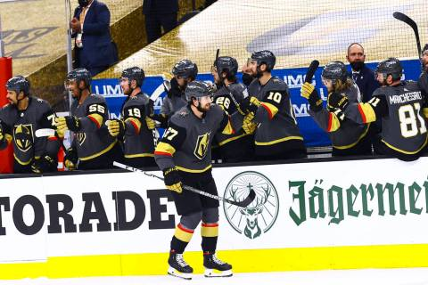 Golden Knights' Shea Theodore (27) celebrates after scoring against the Montreal Canadie ...
