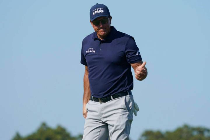 Phil Mickelson leaves the 11th green during the final round at the PGA Championship golf tourna ...