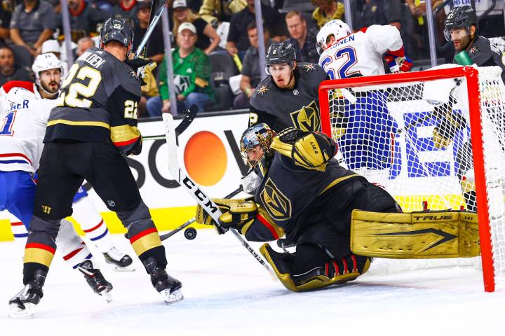 Golden Knights goaltender Marc-Andre Fleury (29) stops the puck against the Montreal Canadiens ...