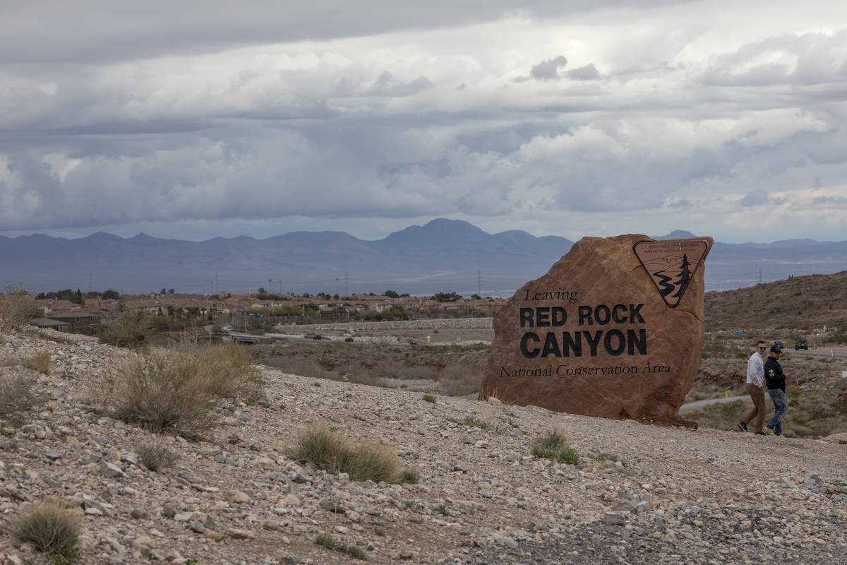 Tourists leave after taking selfies by the Red Rock Canyon sign on Friday, March 13, 2020, in L ...