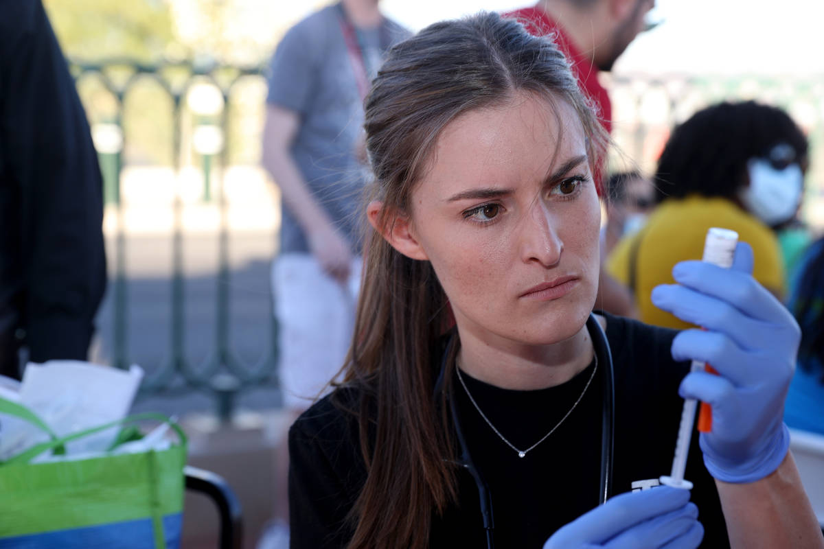Touro University Physician Assistant student Megan Hickey prepares COVID-19 vaccines at the Wel ...