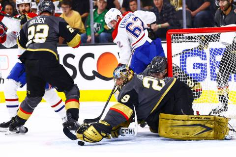 Golden Knights goaltender Marc-Andre Fleury (29) stops the puck in front of Montreal Canadiens' ...