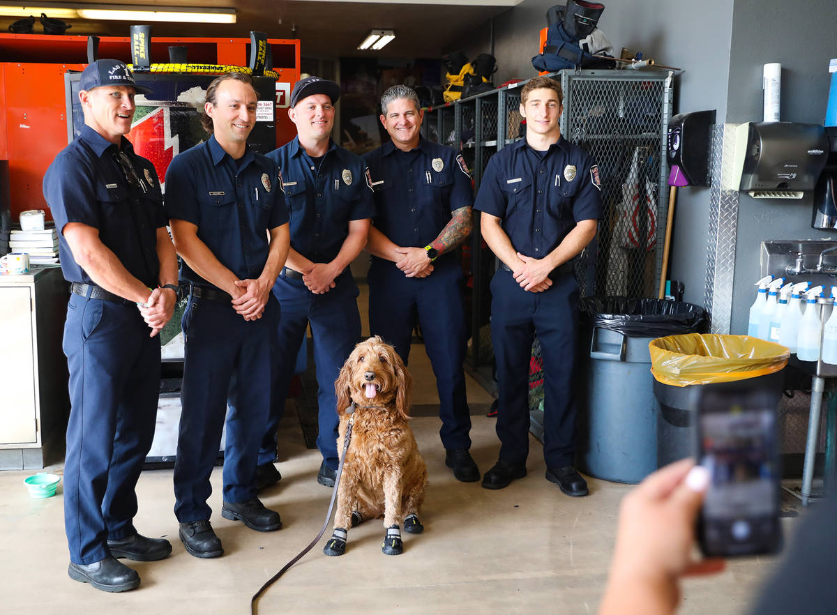 Firefighter Blake Mickelson, from left, Station 1A operations chief Tyler McFate, firefighter B ...