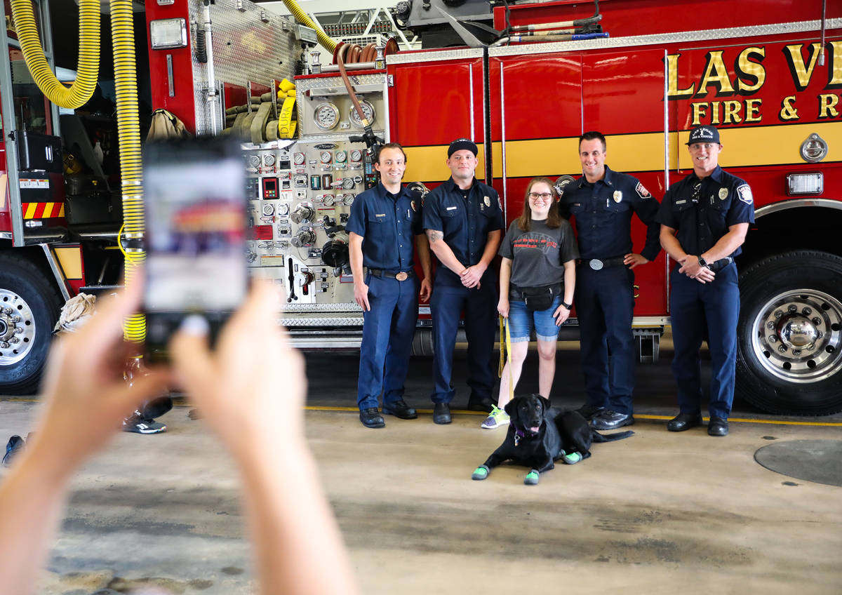 Firefighter Blake Mickelson, from left, firefighter Brian White, Faith Nault, Fire Station 1A C ...