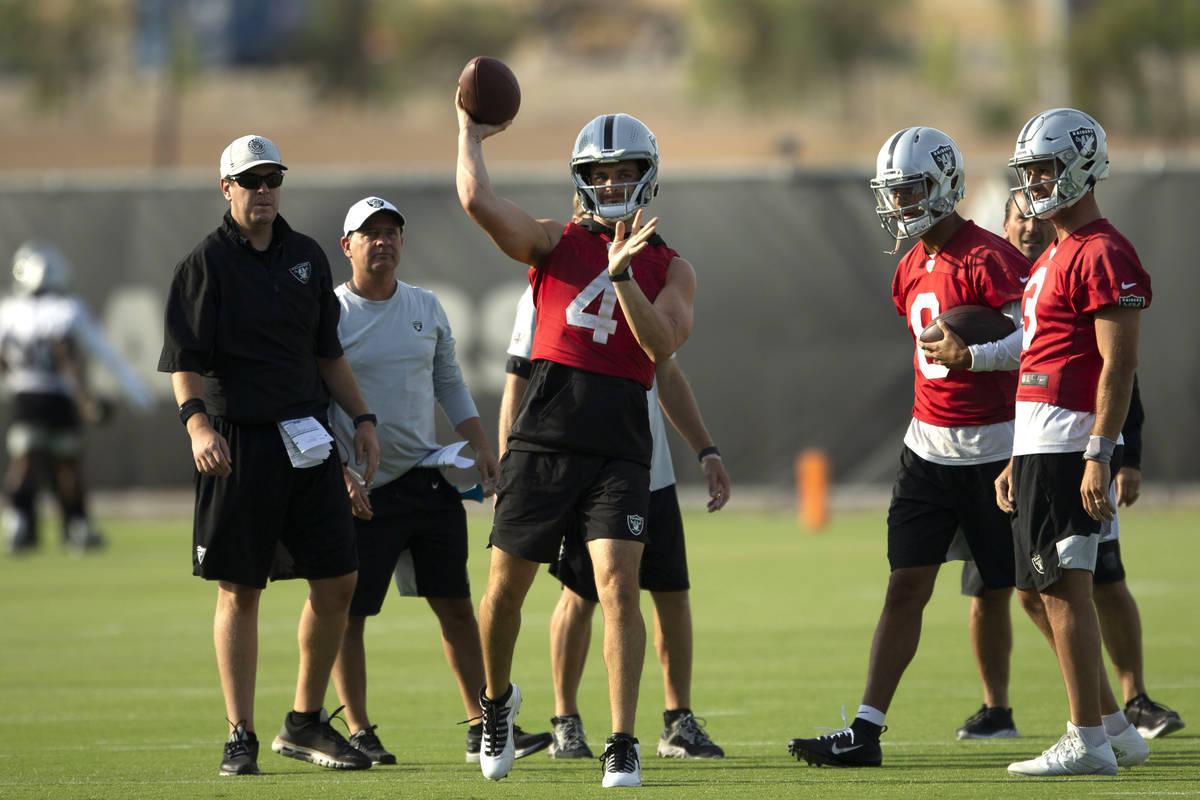 Raiders quarterback Derek Carr (4) throws the football during an NFL football practice on Tuesd ...