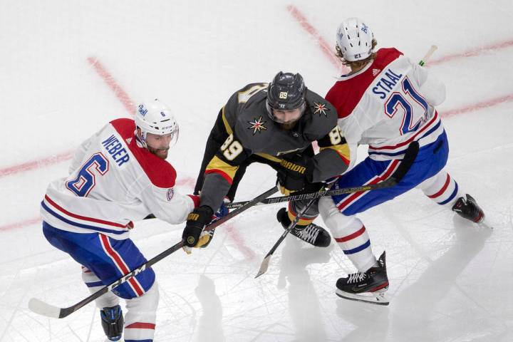 Canadiens defenseman Shea Weber (6) and center Eric Staal (21) block Golden Knights right wing ...
