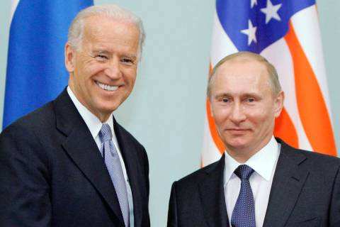 FILE - In this March 10, 2011 file photo, then Vice President Joe Biden, left, shakes hands wi ...