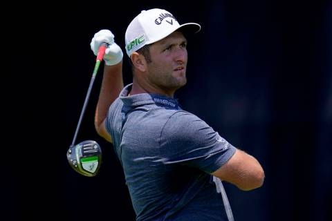 Jon Rahm, of Spain, hits from the seventh tee during a practice round of the U.S. Open Golf Cha ...