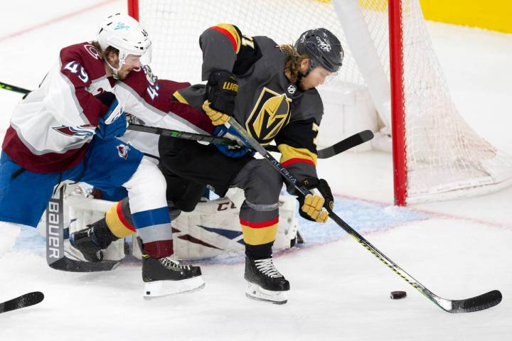 Golden Knights center William Karlsson (71) is about to score a goal on Avalanche goaltender Ph ...