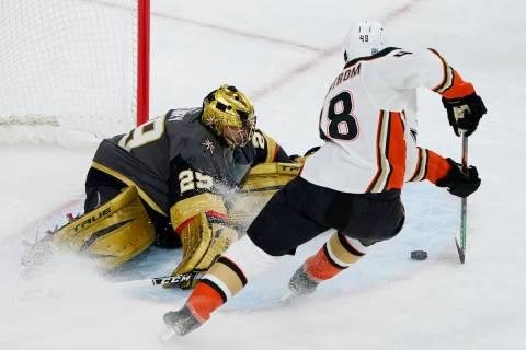 Vegas Golden Knights goaltender Marc-Andre Fleury (29) blocks a shot by Anaheim Ducks center Is ...