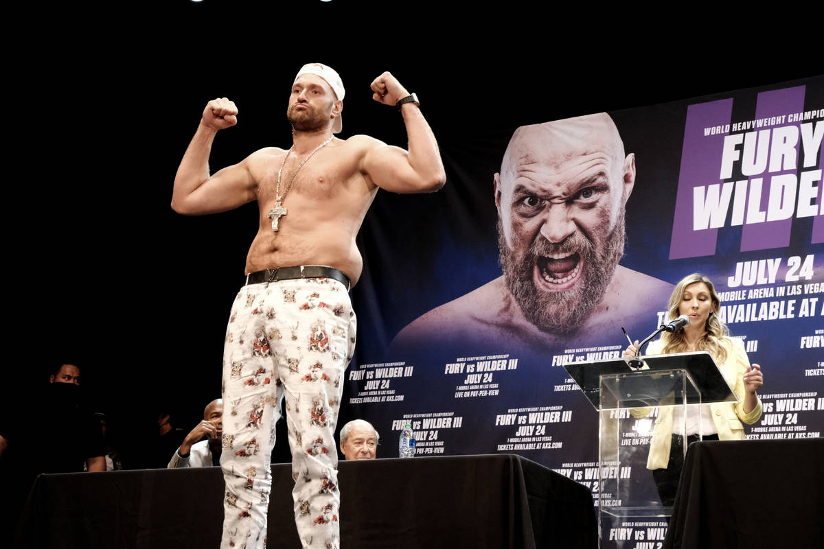 Tyson Fury poses during a news conference with Deontay Wilder in Los Angeles on Tuesday, June 1 ...