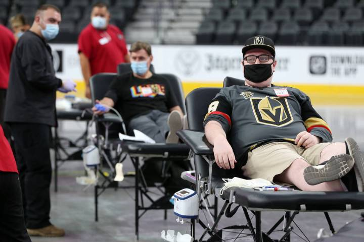 Zach Mueller of Las Vegas participates during a blood donation drive hosted by the American Red ...