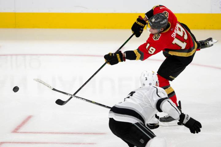 Golden Knights right wing Reilly Smith (19) takes a shot on goal as Kings defenseman Matt Roy ( ...