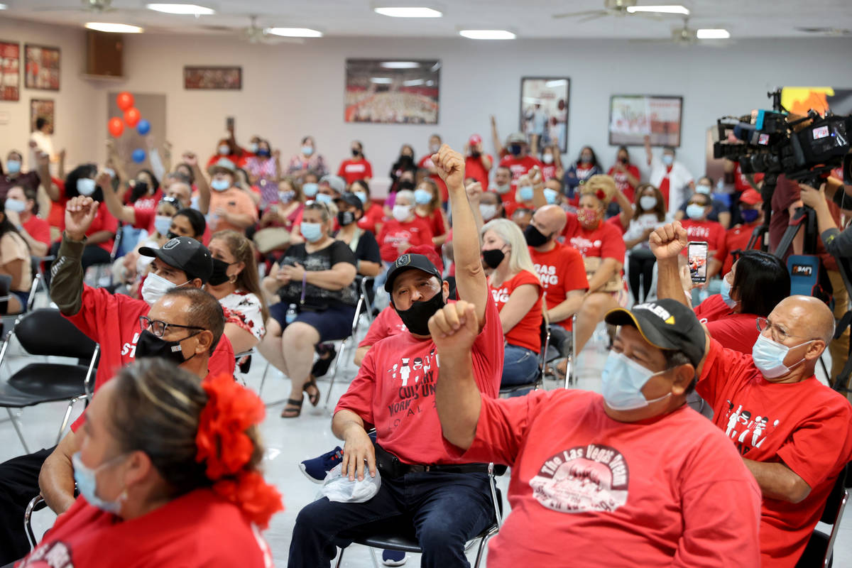 Culinary Workers Union Local 226 members cheer at their union hall in downtown Las Vegas Tuesda ...