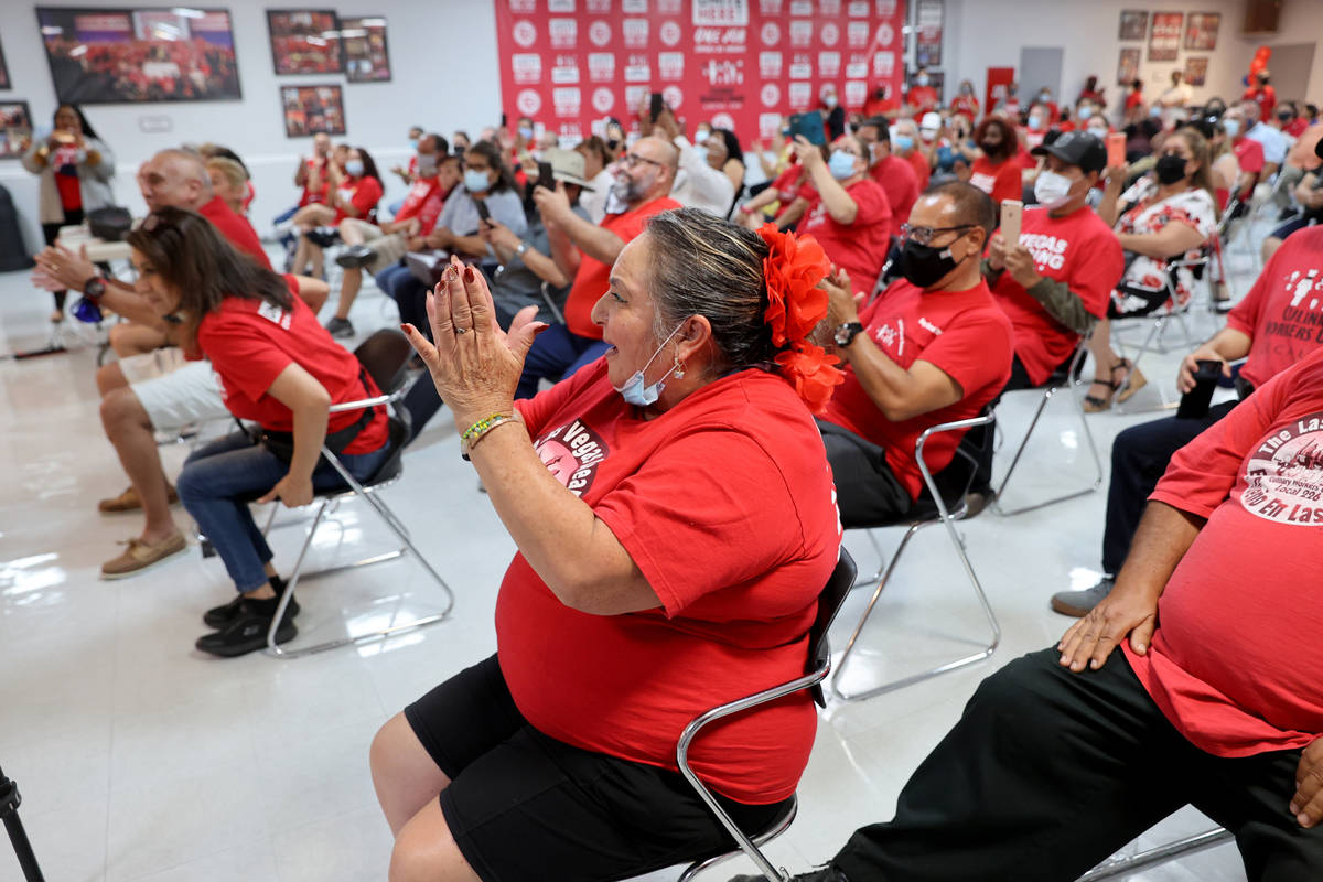 Culinary Workers Union Local 226 members, including Maria Hernandez-Sanchez, cheer at their uni ...